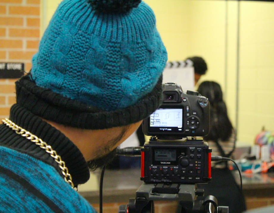 Student filming during a Travis video class